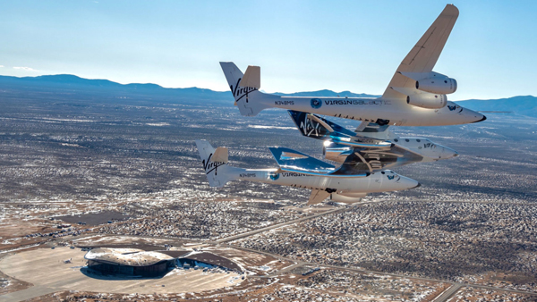 VMS EVE with Spaceshiptwo VSS Unity in captive carry flight above Spaceport America
